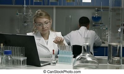 Female scientist conducting an experiment in lab