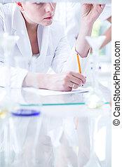 Female scientist during work