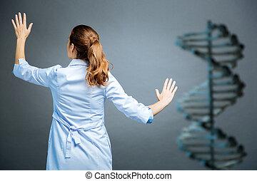 Female scientist working on genetic code