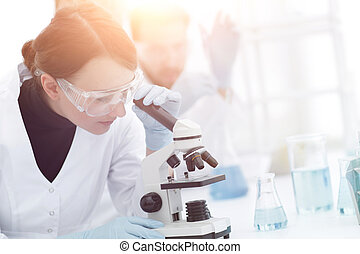 female scientists looking into a microscope