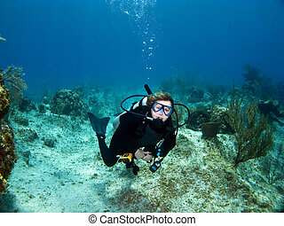Female Scuba Diver looking at the Camera