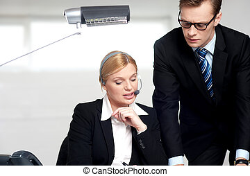 Female secretary explaining to boss