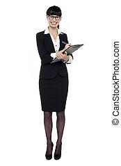 Female secretary jotting down notes on writing pad