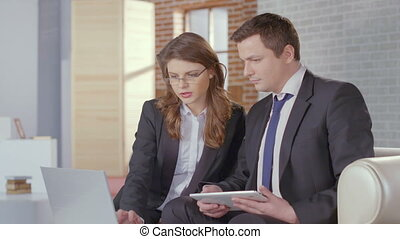 Female secretary showing report to boss, business meeting slowmo