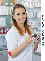 female seller portrait in make-up beauty saloon shop