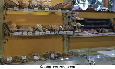 Female seller puts her hands on counter at the pastry shop