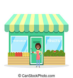 Female seller standing in front of fruit and vegetable store