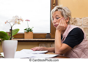 Female senior adult with documents