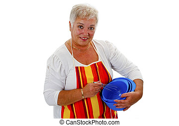 Female senior housewife with bowls and eggbeater - isolated on white background