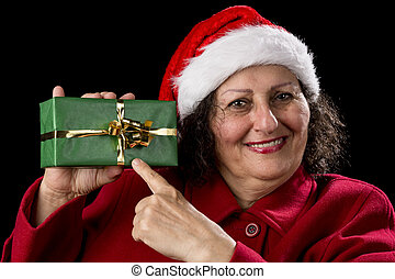 Female Senior Pointing at Green Wrapped Present - Old woman...