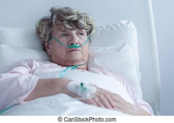 Female senior with nasal cannula
