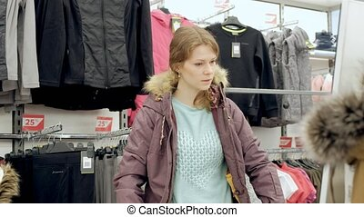 Female Shopping For Sportswear In Sport Clothing Store...
