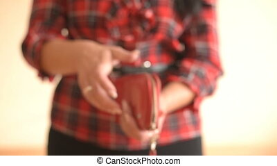 Female Showing Empty Wallet - Young woman shows her empty...