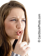 female showing keep shushing sign in anger on an isolated ...