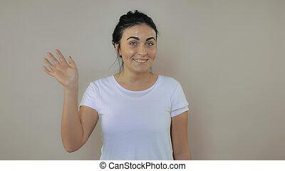 Female shows sign hi