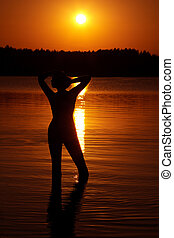 Female silhouette at sunset
