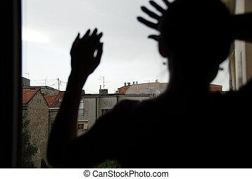 Female silhouette by window - woman black silhouette looking...