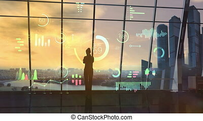 Female silhouette in office examines holographic infographic.