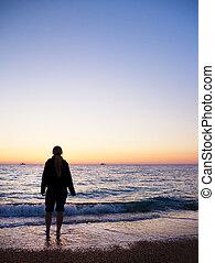 Female silhouette on seacoast