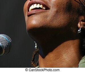 Female singer in performance.