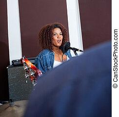 Female Singer Performing In Recording Studio