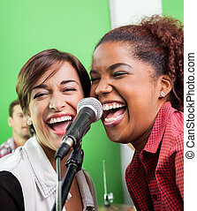 Female Singers Performing In Recording Studio