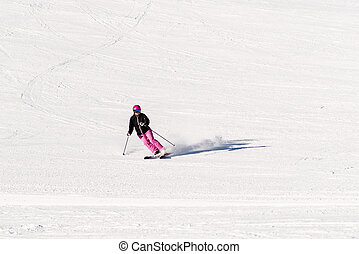 Female skier on empty ski slope - Action shot of a female...
