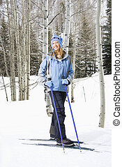 Female skier on slope.