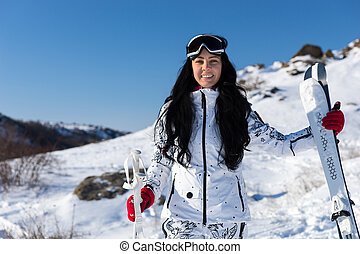 Female Skier with Equipment at Mountain Resort