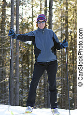 Female skier with the sun behind