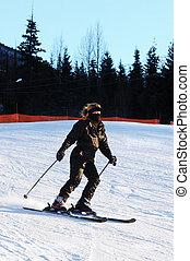 Female Skiier - Female Skiing Down the Mountain