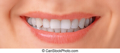 Smile up close  Woman with perfect teeth and big smile shot