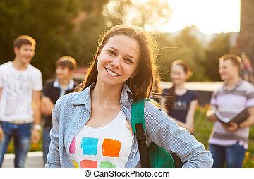 Female smiling student outdoors