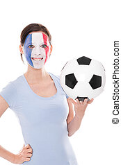 female soccer fan from France holding a football