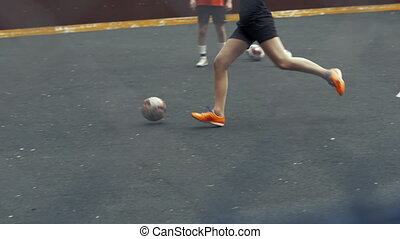 Female soccer player beats ball with his foot. Soccer goal. Woman football