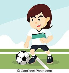 female soccer player dribbling