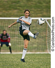 Female soccer player working out on a soccer field