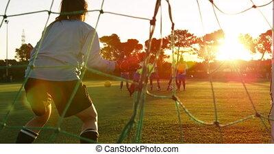 Female soccer player stopping the ball in goal 4k