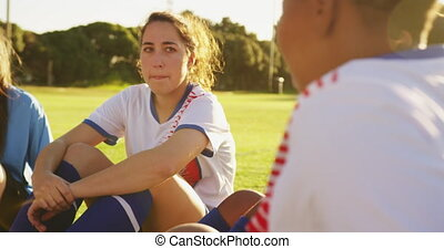 Female soccer team in break time talking on soccer field. 4k...