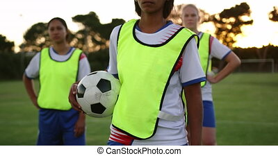 Female soccer team standing on soccer field. 4k - Front view...