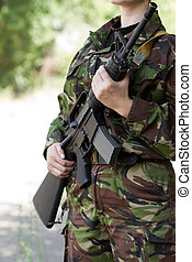 Female soldier witha gun on guard