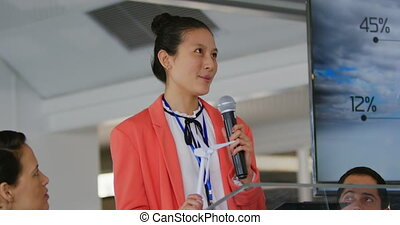 Female speaker addressing the audience at a business conference