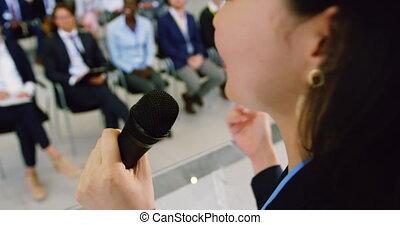 Female speaker speaks in a business seminar 4k