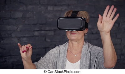 Female spending free time at home in virtual reality glasses...