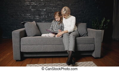 Female spending time and using tablet with her child - Calm...