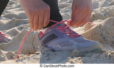 Female sport fitness runner getting ready for jogging...