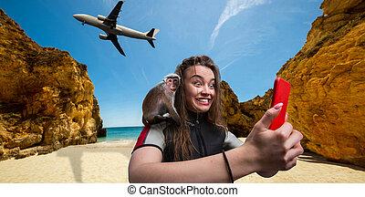 Female sportman windsurfer with phone on the beach