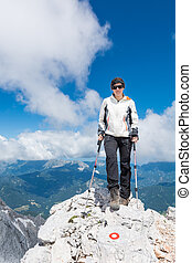 Female standing on top a mountain