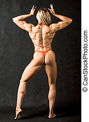 Female strength - Rear view of strong female in red bikini...