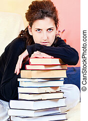 student and bunch of books at home